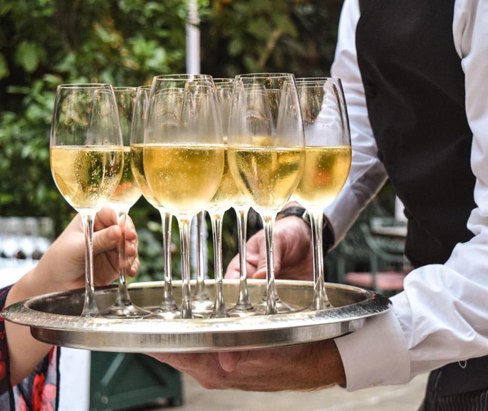 Waiter holding Champagne at Brennan's
