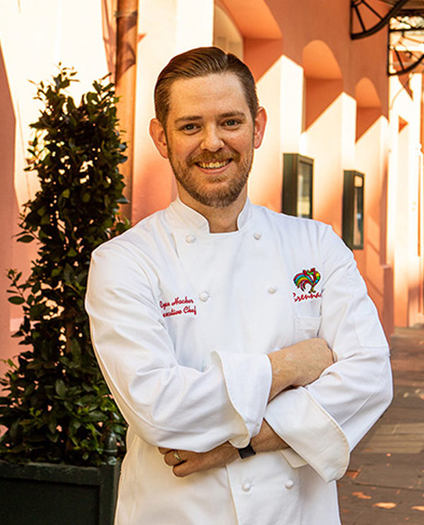 Chef Ryan Hacker standing outside Brennans Restaurant