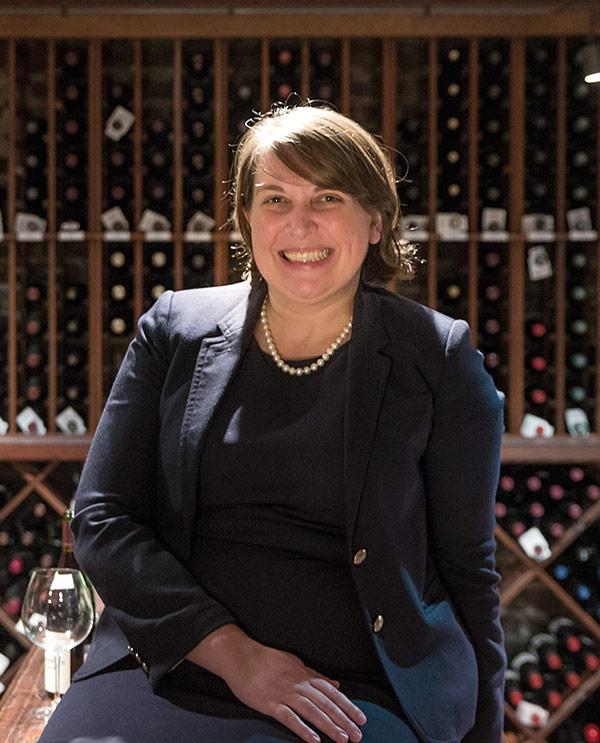 Braithe Tidwell holding a bottle of wine.