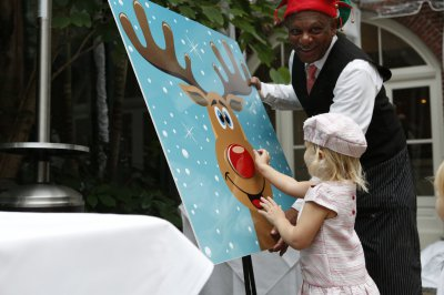 Child playing pin the nose on Rudolph