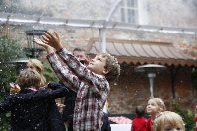 Child playing in fake snow