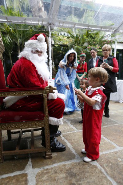 Santa and Ice Queen meeting child