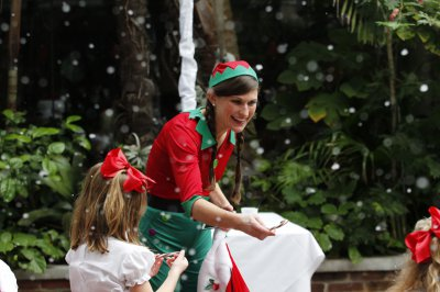 Elf handing out candy to children