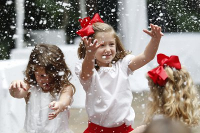 Girls playing in fake snow