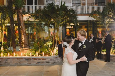 Bride and Groom dance in the courtyard