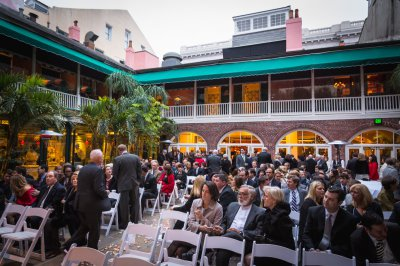Guests grab their seats in the courtyard before the ceremony