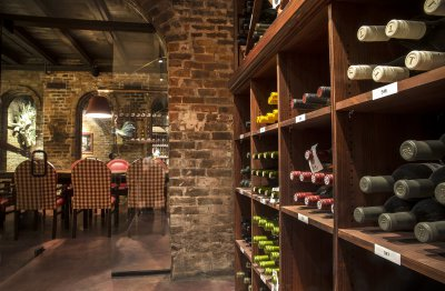Wine Cellar with Wine Room in background