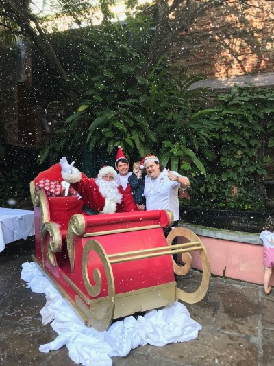 Santa, Elf on the Shelf and Chef Slade Rushing posing by sleigh
