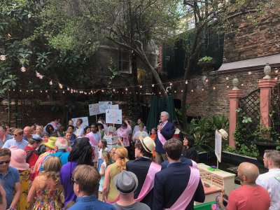 Ralph Brennan addressing the turtle parade crowd in the courtyard