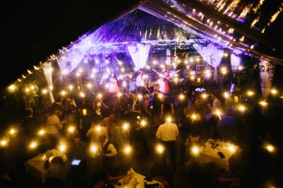 An overhead shot of a tented courtyard reception