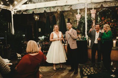 Bride & groom thank guests for coming to their Welcome Party