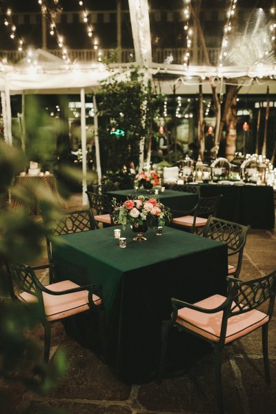 Dark green linens add drama