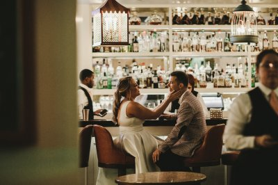 Bride & groom share a moment in the Roost Bar