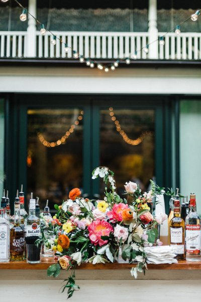 Outdoor bar decked in gorgeous florals