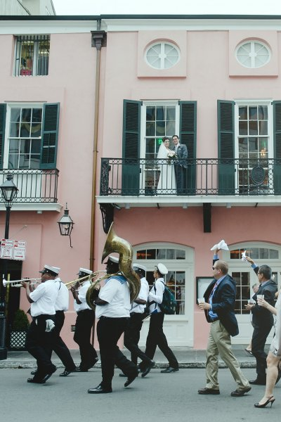 Brass band leads a second line down Royal Street