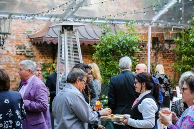 Guests mingling in the courtyard