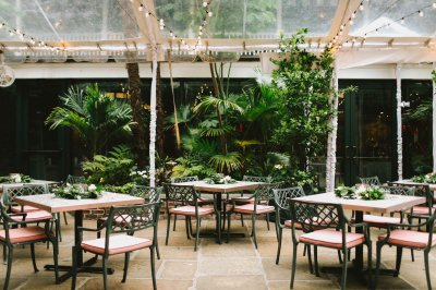 Courtyard tables decorated with florals
