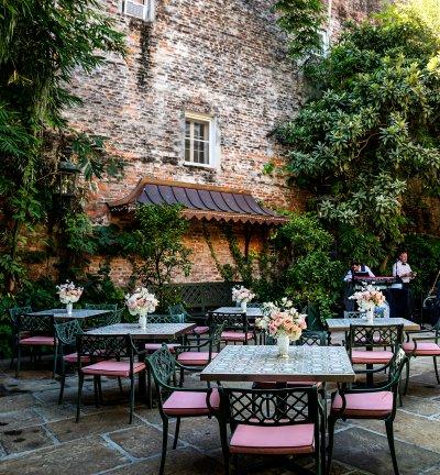 Courtyard tables set with floral arrangements