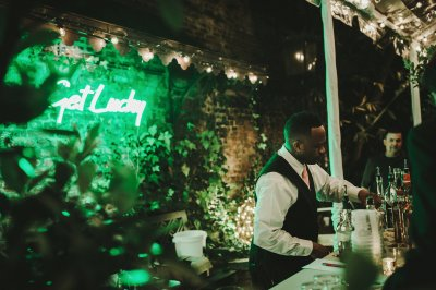 A server prepares drinks in the courtyard